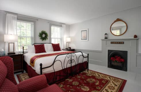Grays Beach Guest Room king bed, fireplace, night tables, area rug, lights and art deco