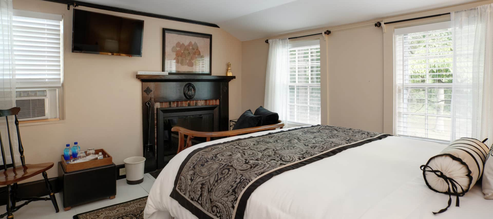 Orleans guest room viewing queen bed, fireplace, seating area