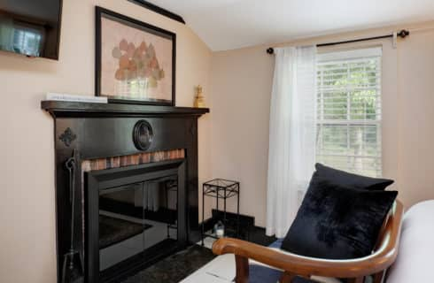 Orleans guest room viewing fireplace, artwork, window and loveseat