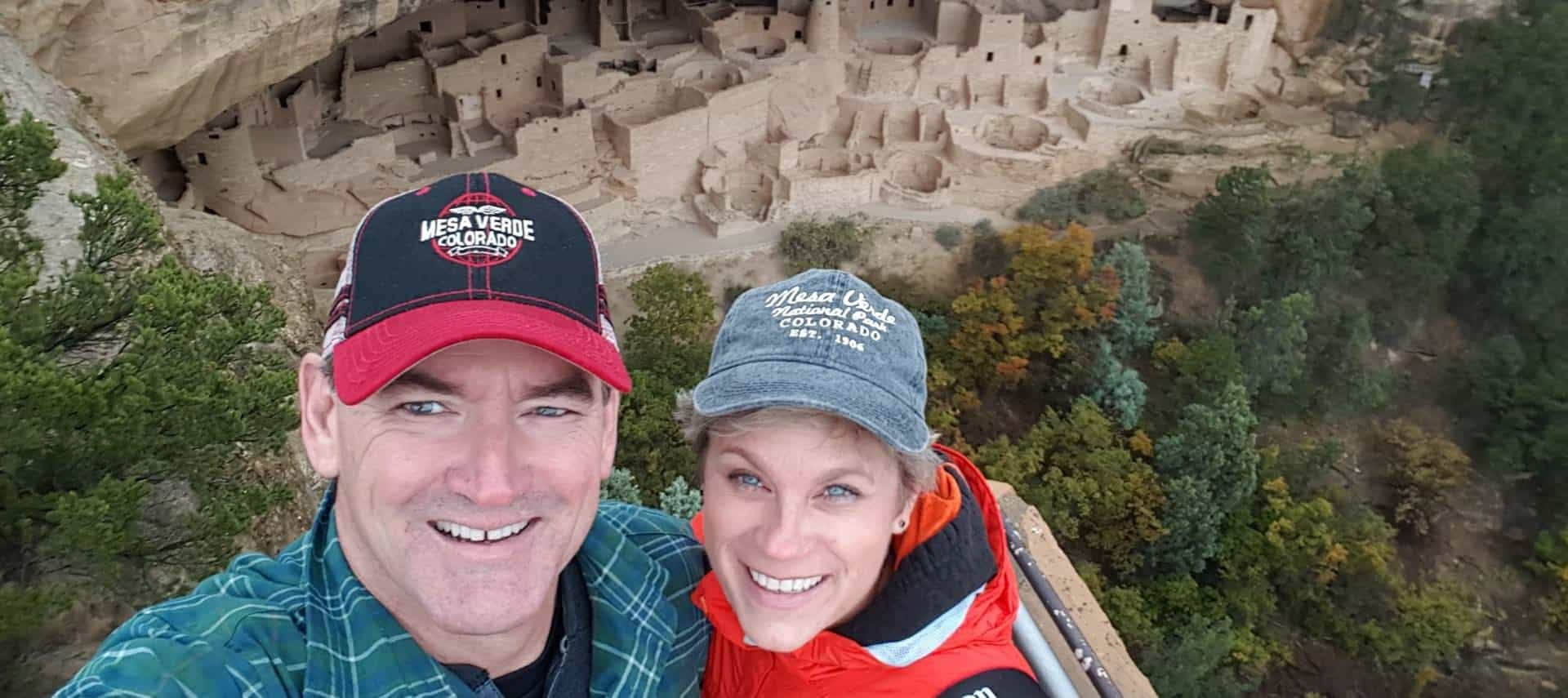 Innkeepers standing in front of old ruins at Mesa Verde National Park in Colorado